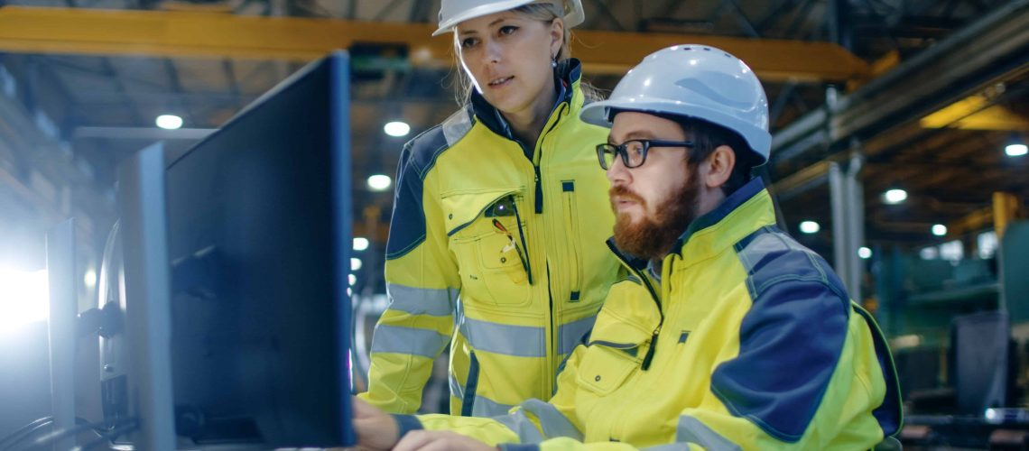 DCO Engineers looking at Computer
