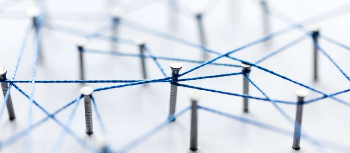 A large grid of pins connected with string. Communication, technology, network concept